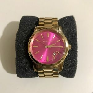 Gold Michael kors watch with Pink face